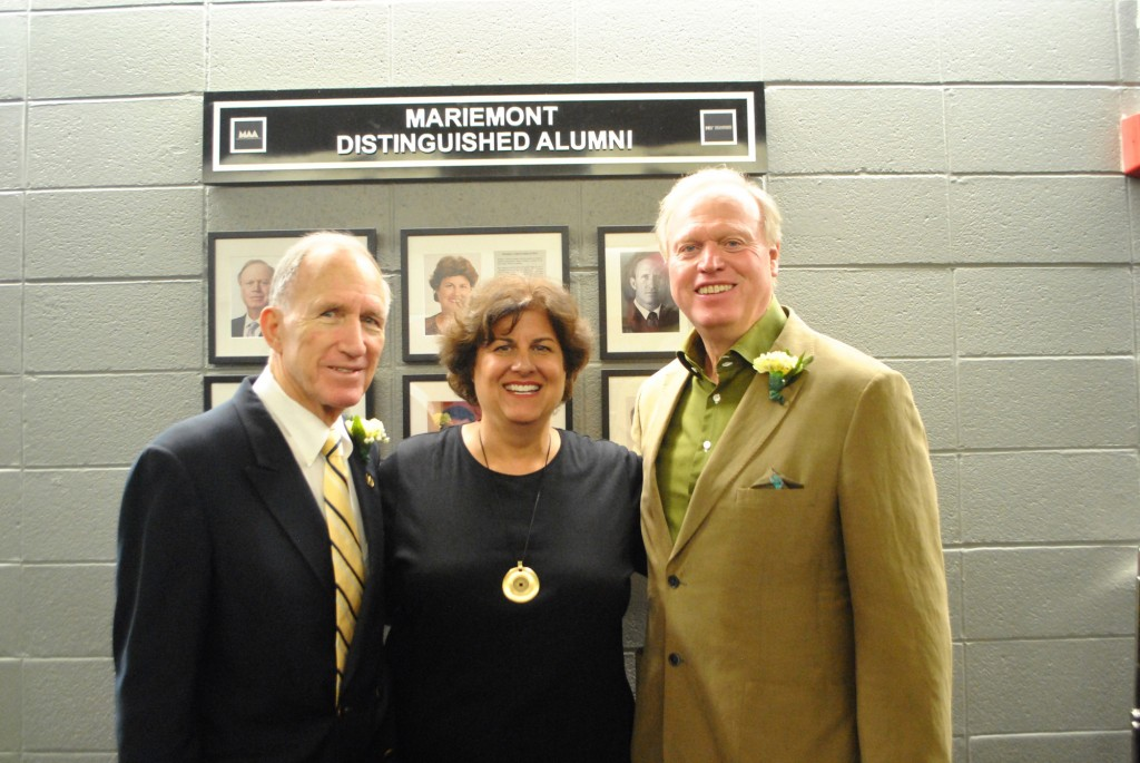 The three Distinguished Alumni stand in front of their plaques that now hang in the College and Career Planning Center at Mariemont High School. Harry N. Walters (left), Pamela J. Coburn (center) and Jeffrey R. Anderson (right) received the award prior to Mariemont High School's  homecoming football game on October 3.