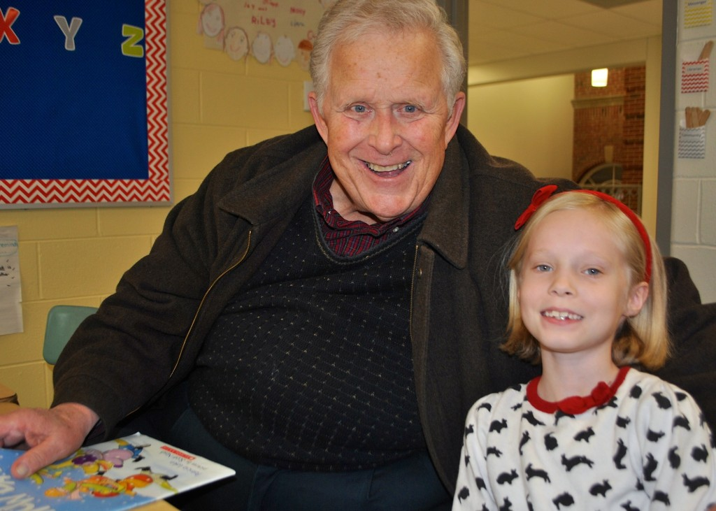 Mariemont Elementary 1st grade student Chloe Hoover from Mariemont with her special grandparent visitor Tony Brueneman from Madisonville.
