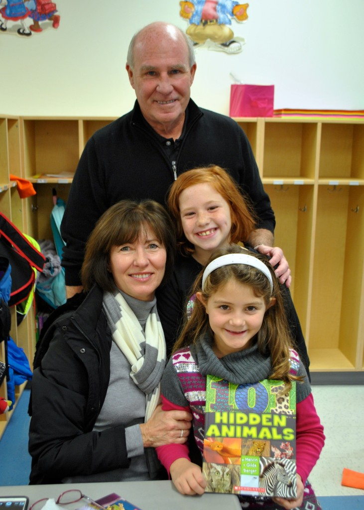 Second grade student Hadley Moore and 3rd grade student Kayla Nevius enjoy time with their grandparents Mike and Sue Moore from Michigan at Mariemont Elementary.